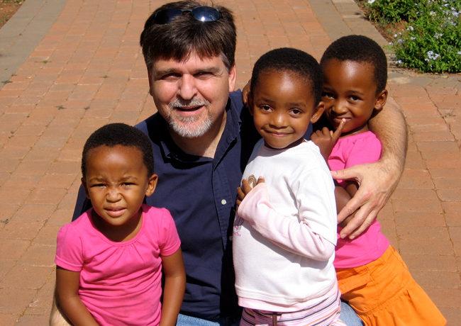 Ray and children in Botswana